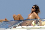 Cindy Crawford topless on a yacht